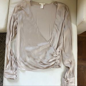 Elegant beige blouse with detailed buttons